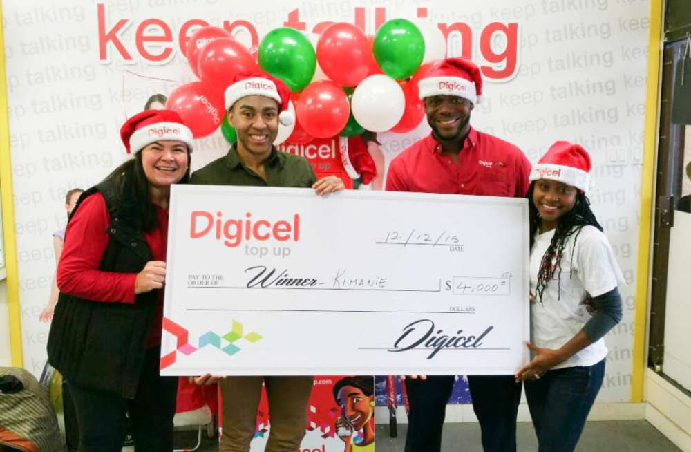TOP UP TO WIN! Digicel gives away $4,000 to lucky customer